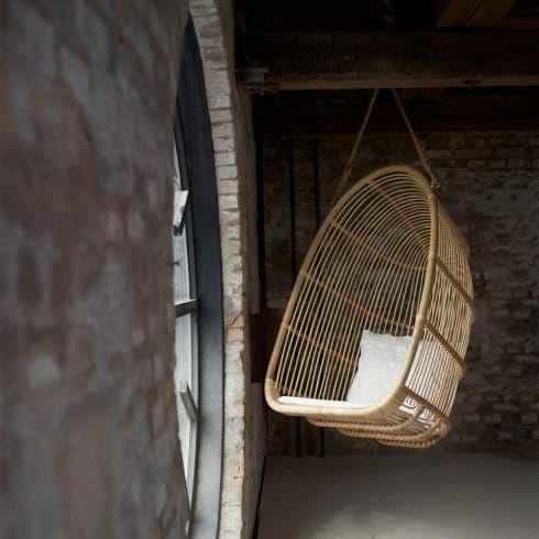 Indoors hanging chair next to window